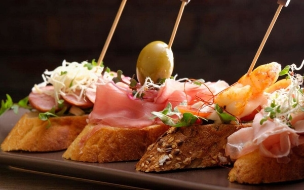 Pilgrimage on the Camino de Santiago: Go on a tapas route in Galicia.