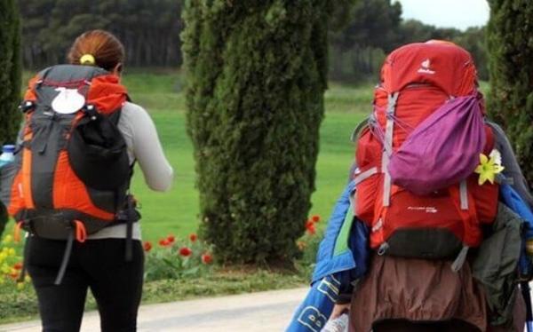 Pilgrims loading their backpacks